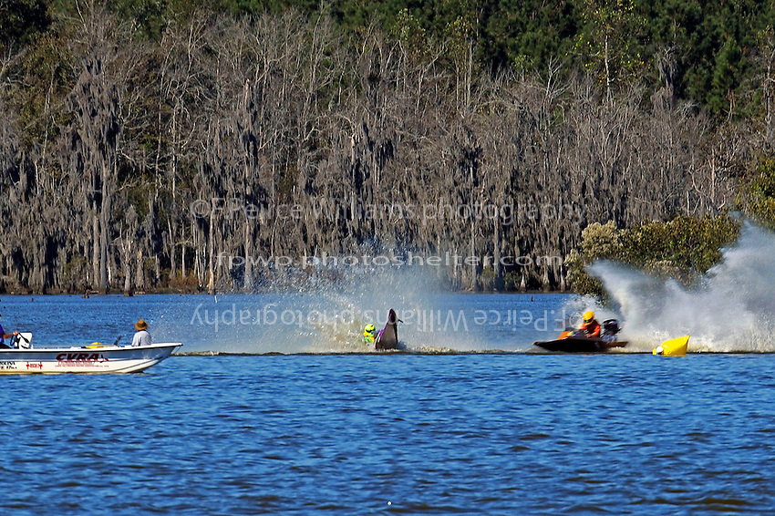 Frame 4: Erin Pittman, 6-H spins to stop in turn one, dumping her out.   (outboard hydroplane)