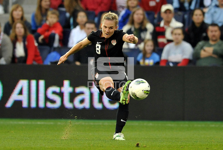 USWNT midfielder Amy Rodriguez (8) shoots on goal.
