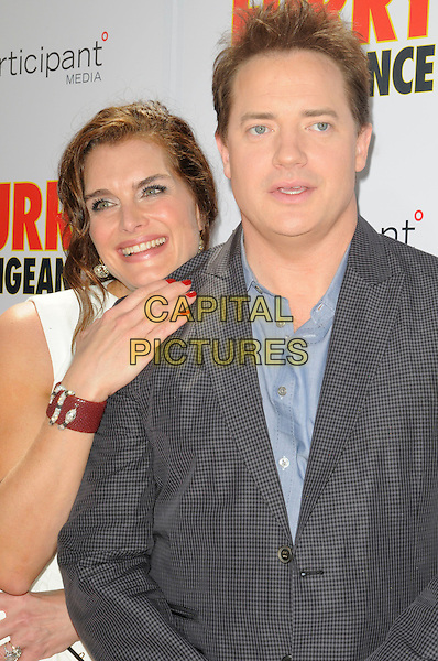 "BROOKE SHIELDS & BRENDAN FRASER .The Los Angeles premiere of ""Furry Vengeance"" at Mann Bruin Theatre in Westwood, California, USA..April 18th, 2010 .half length white sleeveless grey gray blue suit jacket check shirt red nail varnish bracelet .CAP/ROT.©Lee Roth/Capital Pictures"