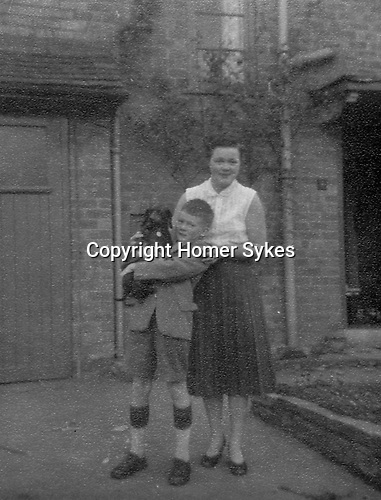 Homer Warwick Sykes, with Beezee and mother Helen Elsie Sykes. Home 4 Cornfield Road, Northfield, Birmingham 1959 ish (Downs school uniform )