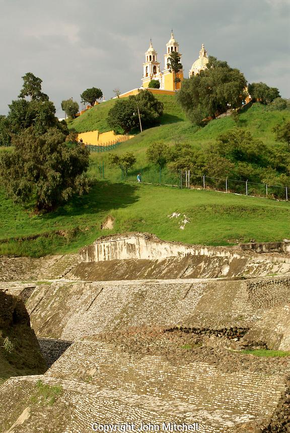 Pre-Hispanic ruins at base of Tapaneca Pyramid  and Santuario de Nuestra Senora de los Remedios church in Cholula, Puebla, Mexico. Cholula is a UNESCO World Heritage Site.