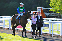 Winner of The Saunton Sands Hotel North Devon Maiden Stakes Amplify ridden by Jason Watson and trained by Brain Meehan is led into the Winners enclosure during Evening Racing at Salisbury Racecourse on 25th May 2019