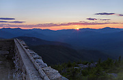 Sunset from Middle Sister Mountain in Albany, New Hampshire during the summer months. Remnants of the old Middle Sister fire tower are in the foreground.