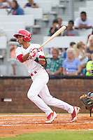 Oscar Mercado (4) of the Johnson City Cardinals follows through on his swing against the Elizabethton Twins at Cardinal Park on July 27, 2014 in Johnson City, Tennessee.  The game was suspended in the top of the 5th inning with the Twins leading the Cardinals 7-6.  (Brian Westerholt/Four Seam Images)