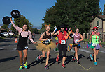 Runners in costume head towards the finish line of the 49th Annual Journal Jog in Reno, Nevada on Sunday, September 10, 2017.