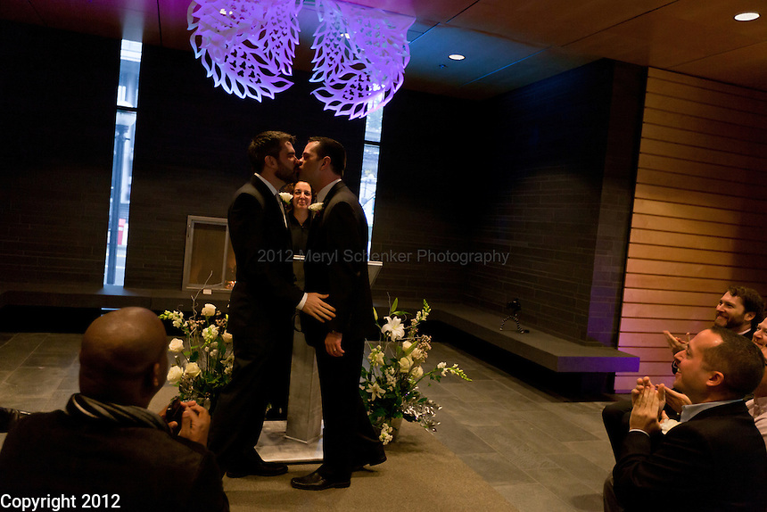 Stephen Phillips, left, and Bruce Sprague of Seattle get married at Seattle City Hall on December 9, 2012. The couple have been together for 17 years. 138 couples were married on Sunday.