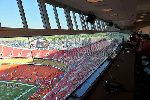Aug 25, 2010; Kansas City, MO, USA; Reporters work from the newly renovated press room while Chiefs Cheerleaders perform on field  before a practice session at Arrowhead Stadium. Mandatory Credit: Denny Medley-US PRESSWIRE