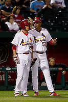 Ryan Jackson (23) of the Springfield Cardinals talks with Manager Ron Warner (57) during a game against the Tulsa Drillers on April 29, 2011 at Hammons Field in Springfield, Missouri.  Photo By David Welker/Four Seam Images.