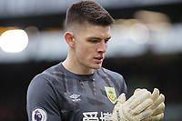2nd February 2020; Turf Moor, Burnley, Lancashire, England; English Premier League Football, Burnley versus Arsenal; Nick Pope of Burnley cleans off his gloves