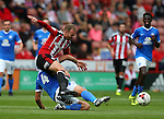 Matt Done of Sheffield Utd tackled by Michael Bostwick of Peterborough Utd  during the League One match at Bramall Lane Stadium, Sheffield. Picture date: September 17th, 2016. Pic Simon Bellis/Sportimage