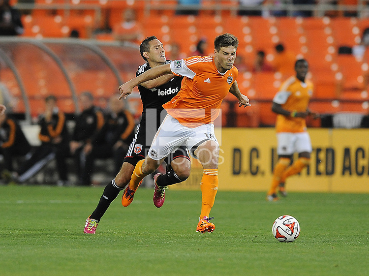 Washington D.C. - May 17, 2014: David Horst (18) of Houston Dynamo goes against Davy Arnaud (8) of D.C. United.  D.C. United defeated  the Houston Dynamo 2-0 during a Major League Soccer match for the 2014 season at RFK Stadium.