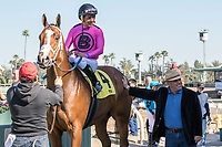 ARCADIA, CA  FEBRUARY 24: #4 Conquest Tsunami, a survivor of the San Luis Rey fire, ridden by Victor Espinoza, in the winners circle after winning the  Daytona Stakes (Grade lll) on February 24, 2018, at Santa Anita Park in Arcadia, CA. (Photo by Casey Phillips/ Eclipse Sportswire/ Getty Images)