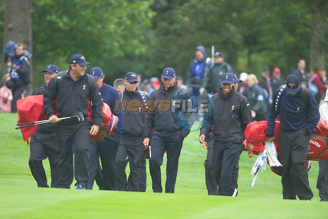 20th September, 2006. The American Ryder Cup team walking down the first fairway, to the jeers of fans having failed to play a single shot off the tee box much to the disappointment of the huge crowds waiting patiently in the wind and the rain during practise Day 2 of the Palmer Course at the K CLub..Photo: Eoin Clarke/ Newsfile.<br />