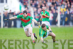Colm Kissane of Beal gets the better of Eamonn Fitzmaurice of Finuge in the Bernard O'Callaghan Memorial Senior Football Championship Final last Sunday in Ballylongford.