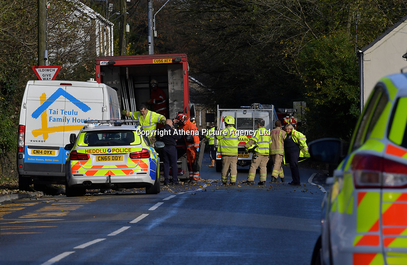 Pictured: Police and fire service at the scene of the crash in Trebanos, south Wales, UK.<br /> Re: Jason Thomas and girlfriend Naomi Carter have died and a baby has been taken to hospital after the car they were travelling in crashed into a lamp-post in the Swansea Valley, Wales, UK.<br /> South Wales Police was called to Swansea Road, Trebanos, in the county of Neath Port Talbot at about 3:15am of Saturday.<br /> The 23-year-old male driver and a female passenger, 18, were killed. 11-month-old baby Brogan was taken to hospital with non life-threatening injuries.<br /> Police have appealed for witnesses.