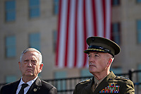 General Joseph Dunford, Chairman of the Joint Chiefs of Staff, right, and Jim Mattis, United States Secretary of Defense, listen during a ceremony to commemorate the September 11, 2001 terrorist attacks with U.S. President Donald Trump, not pictured, at the Pentagon in Washington, D.C., U.S., on Monday, Sept. 11, 2017. Trump is presiding over his first 9/11 commemoration on the 16th anniversary of the terrorist attacks that killed nearly 3,000 people when hijackers flew commercial airplanes into New York's World Trade Center, the Pentagon and a field near Shanksville, Pennsylvania. <br /> CAP/MPI/CNP/RS<br /> &copy;RS/CNP/MPI/Capital Pictures
