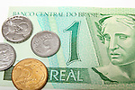 Brazil real money currency paper bill and centavos coins