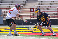 College Park, MD - April 1, 2017: Maryland Terrapins Curtis Corley (42) knocks the ball loose during game between Michigan and Maryland at  Capital One Field at Maryland Stadium in College Park, MD.  (Photo by Elliott Brown/Media Images International)