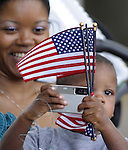 (Boston 070412) Devon Brice, 2,  gets lines up his picture as his mom Lashaunda, enjoys the moment, Wednesday afternoon on the Boston Esplanade, the family was in from Williamsburg Va., for the annual Boston holiday bash  (Jim Michaud Photo)  070412) For Monday