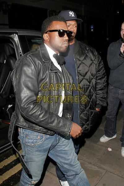 KANYE WEST.LFW, House of Holland, Quaglino's, Bury Street, London, England..February 24th, 2009.London Fashion Week full length car sunglasses shades jeans denim black jacket leather.CAP/AH.©Adam Houghton/Capital Pictures.