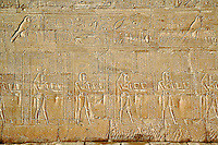 Figures and cartouches on main pylons of entrance to Temple of Horus, Edfu, Egypt