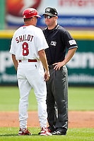 Manager Mike Shildt (8) of the Springfield Cardinals argues a call with an umpire during a game against the Arkansas Travelers at Hammons Field on May 8, 2012 in Springfield, Missouri. (David Welker/ Four Seam Images)