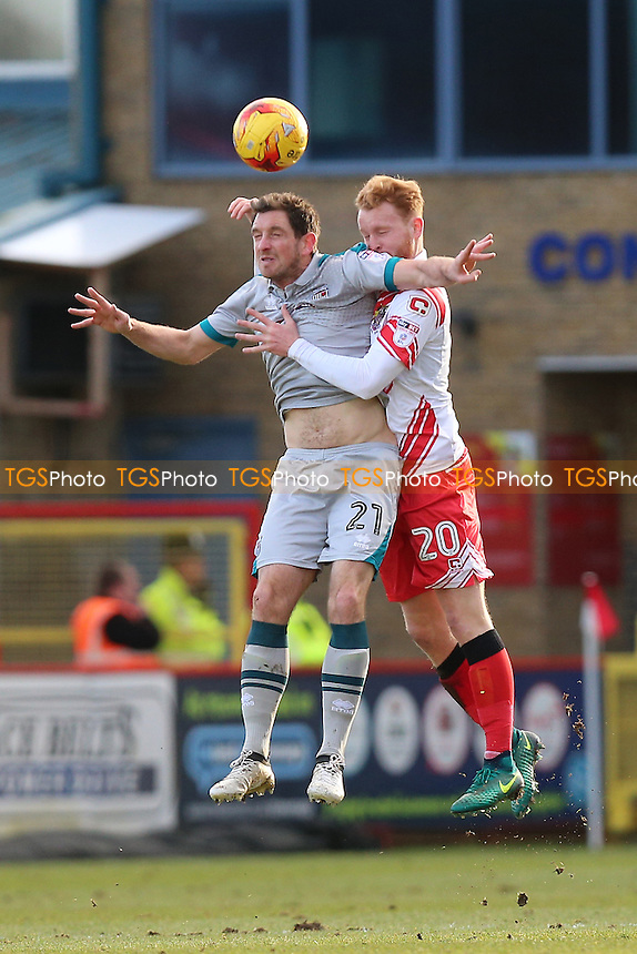 Scott Vernon of Grimsby Town and Connor Ogilvie of Stevenage during Stevenage vs Grimsby Town, Sky Bet EFL League 2 Football at the Lamex Stadium on 28th January 2017