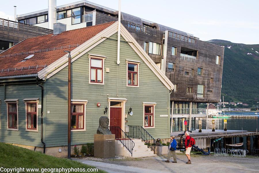 Tourists viewing Roald Amundsen bust statue sculpture at the Polar Museum, Tromso, Norway