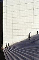 Modern skyskraper office buildings at La Defense complex.  La Grande Arche building. People on stairs. Paris, France.