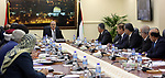 Palestinian Prime Minister Rami hamdallah heads the Palestinian cabinet meeting in the West Bank city of Ramallah on April 11, 2017. Photo by Prime Minister Office