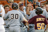 Arizona State Sun Devil bench greets Riccio Torrez #30 after his first inning home run against the Texas Longhorns in NCAA Tournament Super Regional Game #3 on June 12, 2011 at Disch Falk Field in Austin, Texas. (Photo by Andrew Woolley / Four Seam Images)