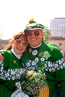 Irish couple age 50 celebrating at the St Patricks day parade.  St Paul  Minnesota USA
