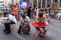 New York,, NY 29 August 2015 Tourists enjoying the pedestrian plaza in Times Square. New York City Mayor Bill de Blasio has designated a Task Force and says he may consider eliminating the pedestrian mall and returning the streets to traffic. Toplessness in New York became legal in New York State in 1993