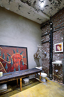 Industrial bathroom with exposed brick wall