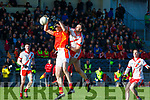 Sean O Gairbhí An Ghaeltacht punches the ball away from Denis Hayes Mallow during the Munster Intermediatte Championship semi final in Mallow on Sunday