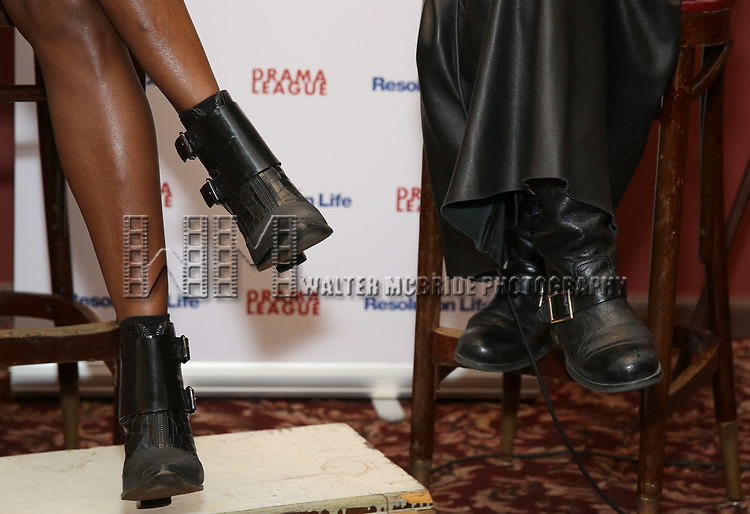 Patina Miller and Bebe Neuwirth, shoe detail, attendsthe 2017 Drama League Award Nominees Announcements at Sardi's on April 19, 2017 in New York City.
