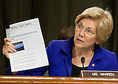 """United States Senator Elizabeth Warren (Democrat of Massachusetts) asks that an article be included in the record as she questions Janet L. Yellen, Chair, Board of Governors of the Federal Reserve System, before the US Senate Committee on Banking, Housing, & Urban Affairs on """"The Semiannual Monetary Policy Report to the Congress"""" on Capitol Hill in Washington, DC on Tuesday, February 14, 2017.<br /> Credit: Ron Sachs / CNP"""