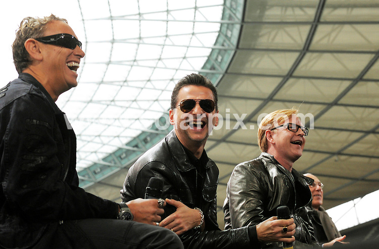 **ALL ROUND PICTURES FROM SOLARPIX.COM**.**SYNDICATION RIGHTS FOR UK AND SPAIN ONLY**.The pop group Depeche Mode at a photocall for their world tour Tour of the Universe? at the Olympiastadion in Berlin in Germany..This pic.Martin Gore, David Gahan and Andrew Fletcher..JOB REF:7538-CPR/Michael Gottschalk DATE:06_10_08.**MUST CREDIT SOLARPIX.COM OR DOUBLE FEE WILL BE CHARGED* *UNDER NO CIRCUMSTANCES IS THIS IMAGE TO BE REPRODUCED FOR ANY ONLINE EDITION WITHOUT PRIOR PERMISSION*
