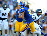 BROOKINGS, SD - SEPTEMBER 26:  Connor Landberg #18 from South Dakota State breaks loose past the defense from Robert Morris in the second quarter Saturday evening at Coughlin Alumni Stadium.  (Photo by Dave Eggen/Inertia)