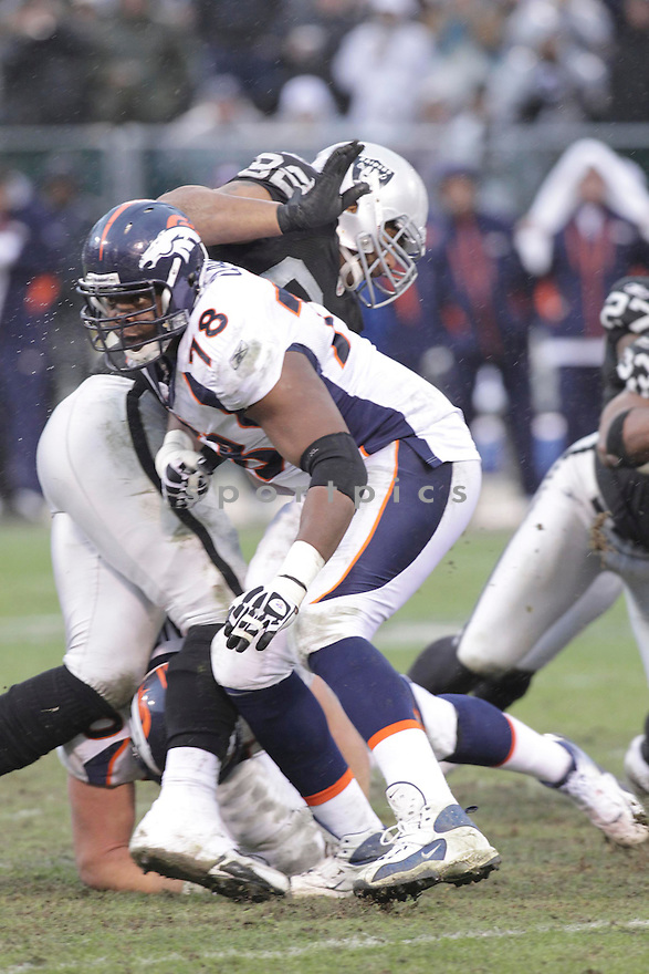 RYAN CLADY, of the Denver Broncos in action durIng the Broncos game against the Oakland Raiders at Oakland-Alameda County Coliseum in Oakland, California on December 19, 2010...Raiders beat the Broncos 39-23
