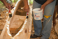 NWA Democrat-Gazette/BEN GOFF @NWABENGOFF<br /> Workers spread epoxy over coconut leaves before joining two parts of the main hull of the KorKor Tuesday, May 8, 2018, at the Shiloh Museum of Ozark History in Springdale. Master canoe builder Liton Beasa and his family, in partnership with the Shiloh Museum of Ozark History, began building the two-man Marshallese canoe called a KorKor April 14 and plan to display the finished canoe at the Little Craft Show Saturday in downtown Springdale.