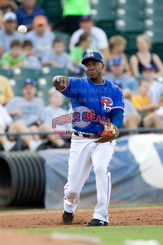 Round Rock Express third baseman Esteban German #6 throws the ball to first during a game against the Memphis Redbirds at the Dell Diamond on July 10, 2011in Round Rock, Texas.  Memphis defeated Round Rock 10-9.  (Andrew Woolley / Four Seam Images)