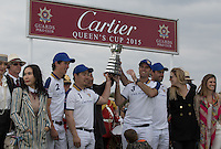 Team King Power Foxes lift the cup after the victory during the Cartier Queens Cup Final match between King Power Foxes and Dubai Polo Team at the Guards Polo Club, Smith's Lawn, Windsor, England on 14 June 2015. Photo by Andy Rowland.