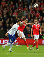 Joe Allen of Wales (C) heads the ball forward during the 2018 FIFA World Cup Qualifier between Wales and Serbia at the Cardiff City Stadium, Wales, UK. Saturday 12 November 2016
