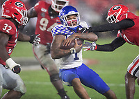 ATHENS, GA - OCTOBER 19: Lynn Bowden Jr. #1 of the Kentucky Wildcats makes a run and is tackled by Tyrique Stevenson #7 and Monty Rice #32 of the Georgia Bulldogs during a game between University of Kentucky Wildcats and University of Georgia Bulldogs at Sanford Stadium on October 19, 2019 in Athens, Georgia.