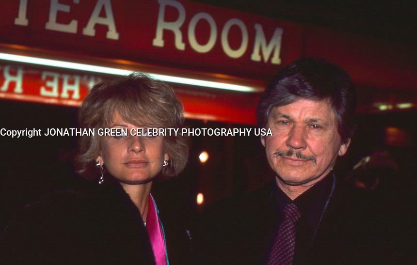 Charles Bronson &amp; Jill Ireland 1986 <br /> By Jonathan Green