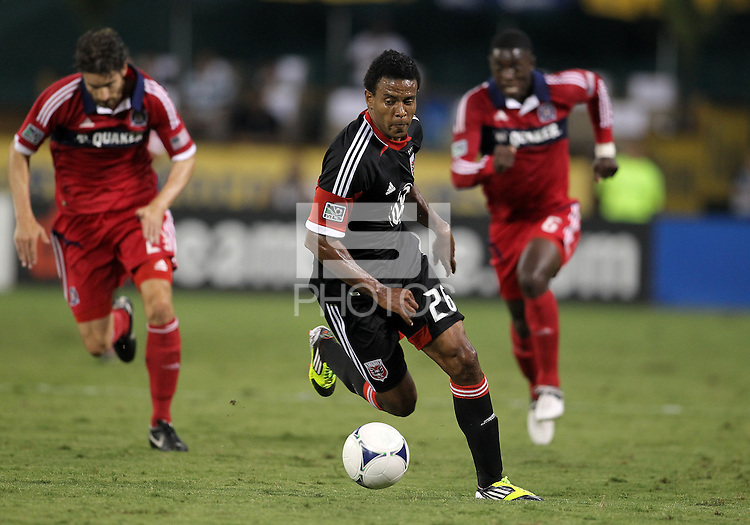 WASHINGTON, DC. - AUGUST 22, 2012:  Lionard Pajoy (26) of DC United races away from Chicago Fire defenders during an MLS match at RFK Stadium, in Washington DC,  on August 22. United won 4-2.