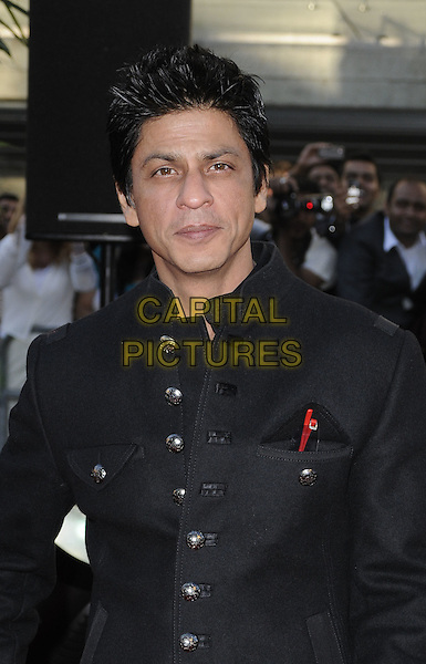 "SHAHRUKH KHAN  .Attending the ""Raavan"" UK film premiere, Belvedere Road, London, England, UK, June 16th 2010..half length black jacket buttons .CAP/CAN.©Can Nguyen/Capital Pictures."