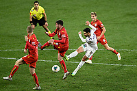 30th July 2020; Bankwest Stadium, Parramatta, New South Wales, Australia; A League Football, Adelaide United versus Perth Glory; Bruno Fornaroli of Perth Glory shoots past the Adelaide defenders to score his goal in the 74th minute to make it 5-2 to Adelaide