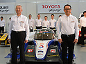January 30, 2014, Tokyo, Japan - President Akio Toyoda, front right, of Japan's Toyota Motor Corp., poses with drivers and staff of its racing tream during a presentation its motor sports activities for 2014 in Tokyo on Thursday, January 30, 2014. They will include participation in the FIA World Endurance Championship and the Le Mans 24-hour race, the NASCAR racing series and the Super GT and Super Formula championships. Toyoda said its motor sports activities through Lexus Racing and Toyota Racing are aimed to bring more joy to more people through automobiles.  (Photo by Natsuki Sakai/AFLO)